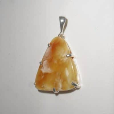 Butterscotch Amber Claw Pendant front